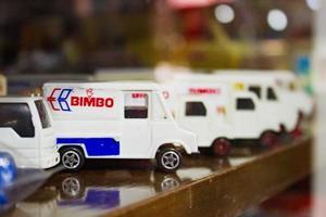 Mexico City, Mexico, 2020- White toy trucks on shelf