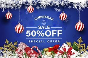 Christmas sale composition with snowflakes and hanging ornaments vector