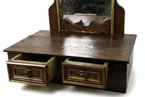 Old Piece of Furniture with Drawers and Mirror photo