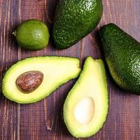 Avocado, lime on a brown background