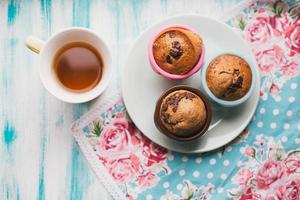 Home made chocolate muffins with herbal tea photo