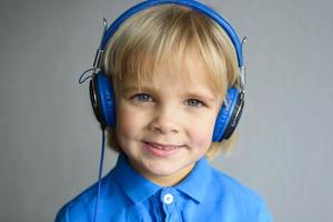 Portrait of a little smiling boy with headphone photo