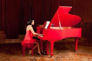 beautiful woman playing the piano photo