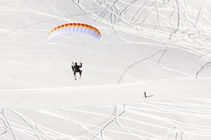 Paraglider in winter Caucasus mountains in Georgia photo