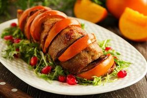 Pork baked with persimmons. photo