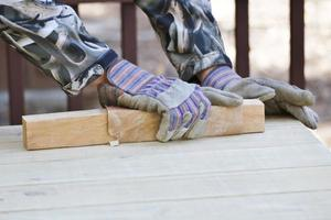 Action: Man sanding and painting photo
