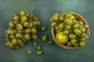 Assortment of fruit on green background photo