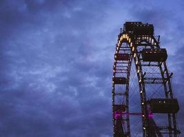 Ferris wheel in front of cloudy sky