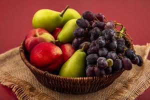 Assorted fruit on red background