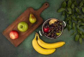 Assorted fruit on stylized green background