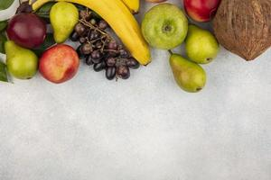 Assorted fruit on neutral background with copy space