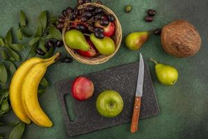 Assorted fruit on green background