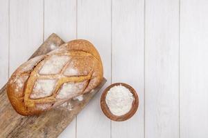 Loaf of fresh bread on cutting board