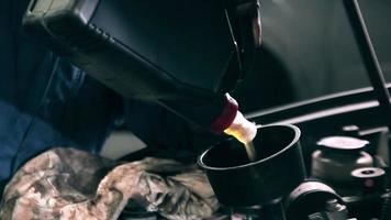 Mechanic top up the engine oil video