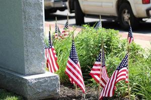 U. S. Flags Around Gravestone