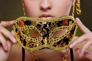 Beautiful girl with a masquerade mask photo
