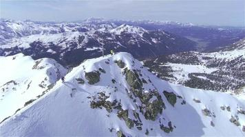 AERIAL: Backcountry skier riding down the big mountain video