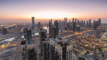 Scenic aerial view of a big modern city day to night timelapse. Business bay, Dubai, United Arab Emirates video