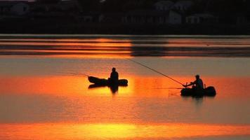 Fishing boats at sunset video