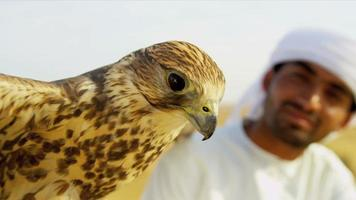 Bird of Prey with Male Middle Eastern Owner