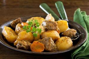 Roast pork and potatoes with spices. photo