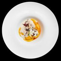 Ravioli with polenta isolated on black