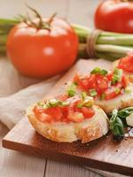 simple italian appetizing bruschetta with tomato and basil, on o