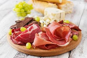 Antipasto catering platter with bacon, jerky, sausage, blue cheese