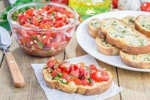 Bruschetta with tomatoes, herbs and oil on garlic cheese bread