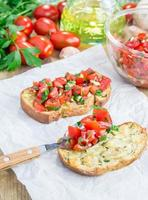 Bruschetta with tomatoes on toasted garlic cheese bread