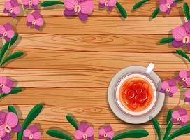 Top view of blank wooden table with tea and flowers