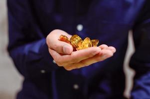 Businessman holding golden coins