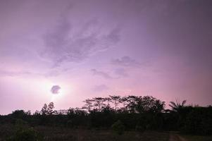 Lightning in the sky at night photo