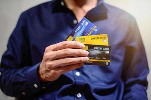 Businessman with credit cards photo