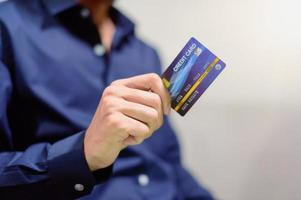 Businessman with credit card photo