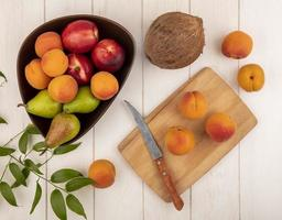 Assorted fruit on neutral background
