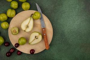 Assorted sliced fruit on cutting board