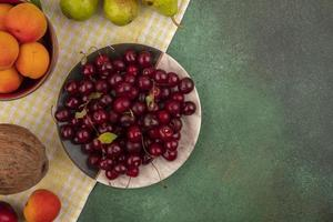 Assorted mid autumn fruit background with copy space