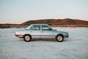 Cape Town, South Africa, 2020 - Grey sedan parked near beach