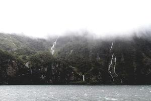 Waterfalls on a mountainside and a lake