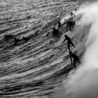 Sydney, Australia, 2020 - Black and white of silhouette of surfers
