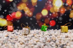 Merry Christmas background with miniature gift boxes