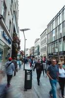 Augsburg, Germany, 2020 - People walking on a sidewalk during daytime