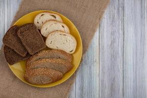 Assorted bread on wooden background