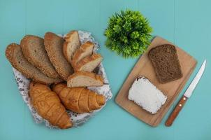 Assorted bread with cheese on blue background