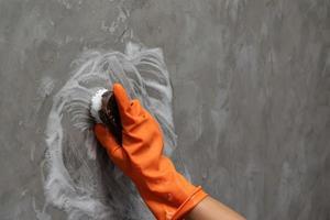 Hand scrubbing a wall