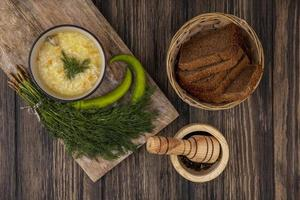 Soup and bread on wooden background photo
