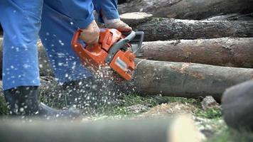 Working with chainsaw in slow motion video