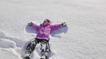 HD Slow-Mo: Little Girl Makes an Angel in the Snow video