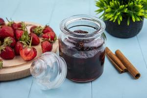 Berry jam in a jar on a blue background